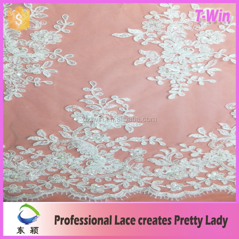 New fashion embroidered tulle fabric/hot manufacturer brocade lace fabric wedding/wholesale lace long sleeve short wedding dress