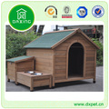 Wooden outside dog house with feeder