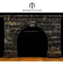 A Victorian Portoro Marble antique arched fireplace surround black marble fireplace mantel
