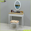 Wall mounted dressing table with An oval mirror and a lining stool