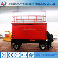 new indoor warehouse electric powered hydraulic loading use towable movable personnel lifting cargo mini scissor lift platform