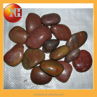 Red Mexican beach pebbles for garden decoration