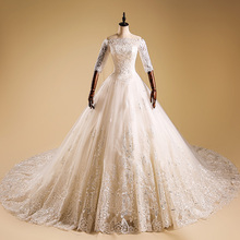 WD022 Heavy handmade lace decorates off shoulder luxury trailing beach wedding dress