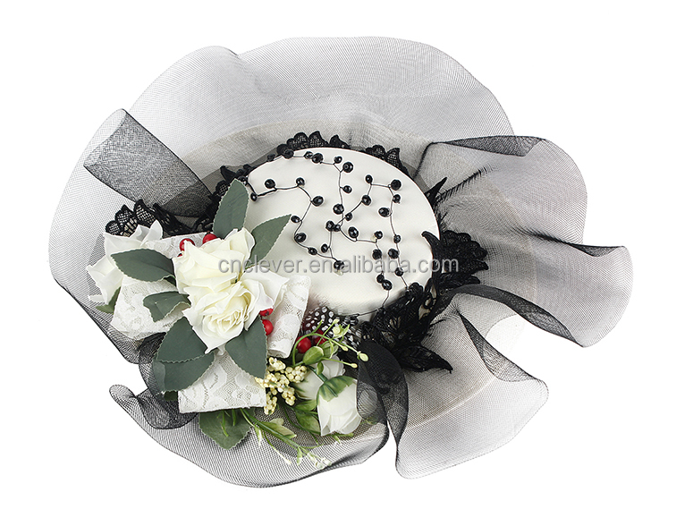 White flowers intersperse wedding headwear with black transparent gauze