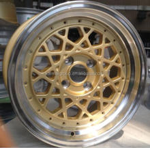 gold 18x9.5 inch alloy wheel with 5 bolt holes