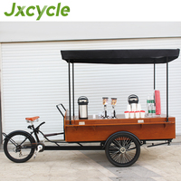 A cool mobile empresso machine stand in the coffee bike/cafe tricycle
