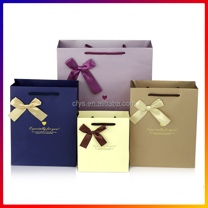 China Factory customized size paper gift bag with handle Luxury gift paper bag with ribbon design