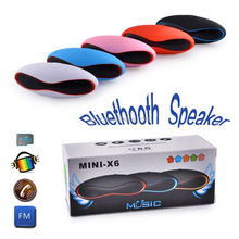 New portable wireless bluetooth audio player mini-x6,Mini rugby football style wireless speaker car subwoofer sound