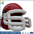 Factory price inflatable sports helmet inflatable promotion shape inflatable team helmets with tunnel