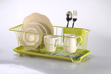 green dish rack with plastic tray