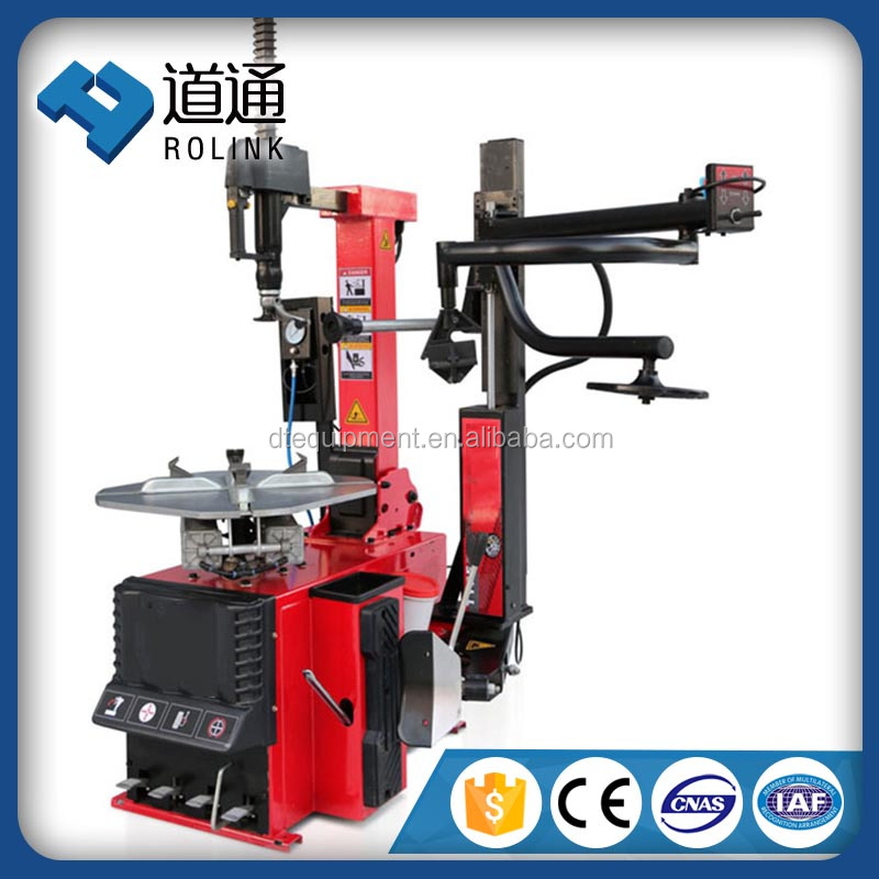 Pneumatic operated automatic tilting tyre changer with helper arm