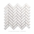 white marble herringbone mosaic bathroom floor tiles