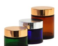 Empty glass jars with different color: amber, cobalt blue and green