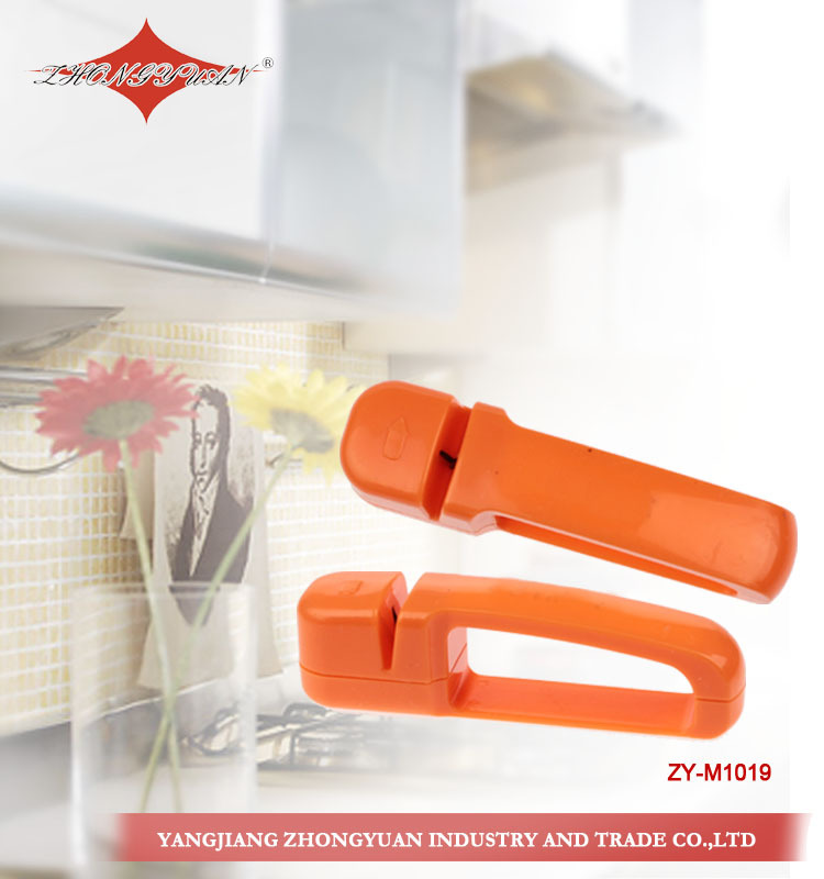 Precision edge knife or scissors sharpener with full length safety handle