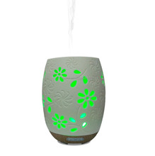 Soft touching housing electronic ceramic flower aroma oil diffuser