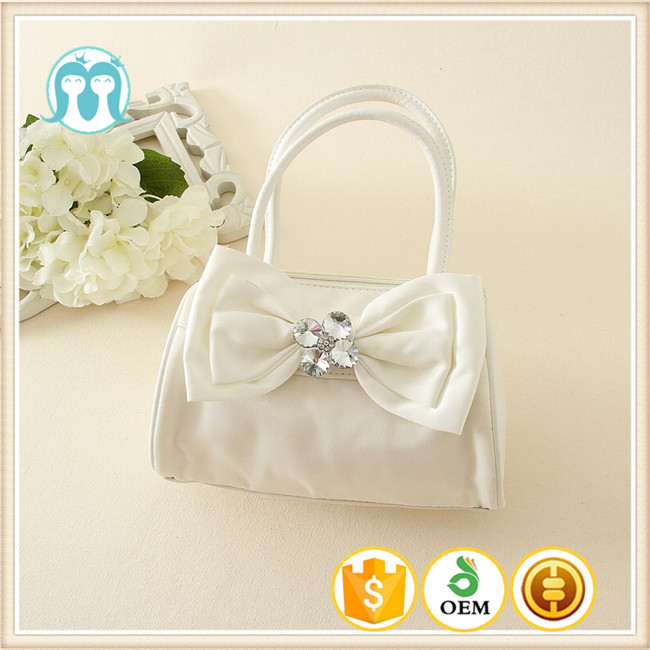Best price Cute Little Girls pink and beige bags Colorful Bowknot PU good quality Kids Handbags from chinese factory
