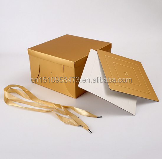Luxury golden royal birthday gift packing box with ribbon and platform inside