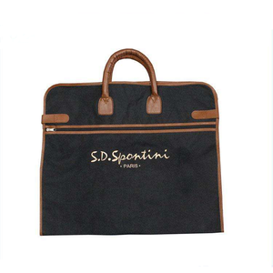 Polyester garment bag with leather handle