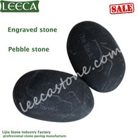 Black pebble engraved stone
