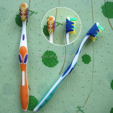 New design yangzhou toothbrush with tongue cleaner