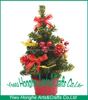 artificial small christmas tree with colorful ribbon and ball for festival