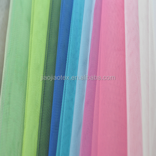 China manufacturer polyester tulle wholesale fabric for wedding dress