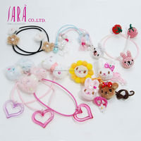 Cute pink rabbit hair tie as traditional hair accessories for kids