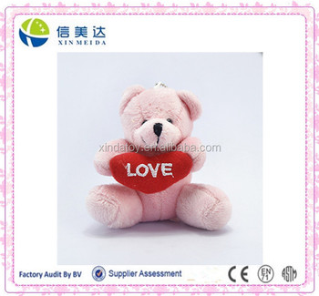 Pink teddy bear with a red love heart party gift