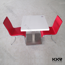 kitchen table and chairs with red chairs