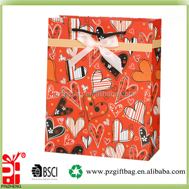 Alibaba China new arrival decorative heart design valentine gift paper bag with bow tie wholesale