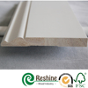 White primed interior flooring wood molding baseboard