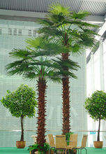 artificial big tropical palm tree for decorate the inside place