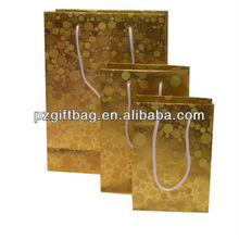 Alibaba china bling bling gift paper bag, luxury gold spot paper shopping bag
