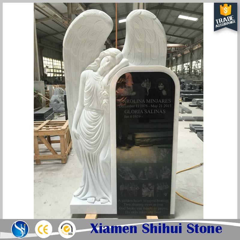 Big white angel tombstone monument with letter carved design