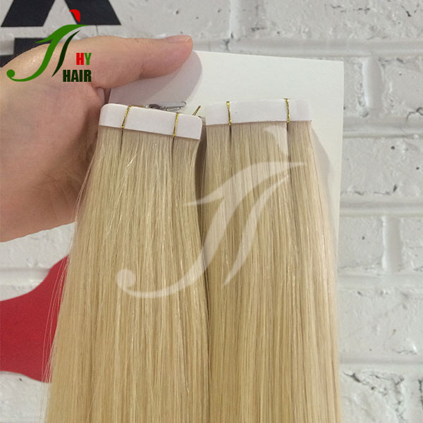 China human hair factory wholesale price tape hair extension best remy tape in hair extension in market