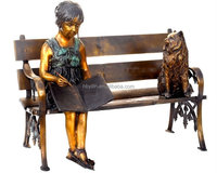 Bronze Girl reading book on bench statue