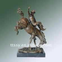 Bronze man riding horse statue