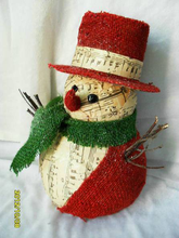 arts and crafts newspaper red sack cloth cap snowman