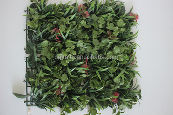 artificial hand-made plastic boxwood hedge with flower decoration