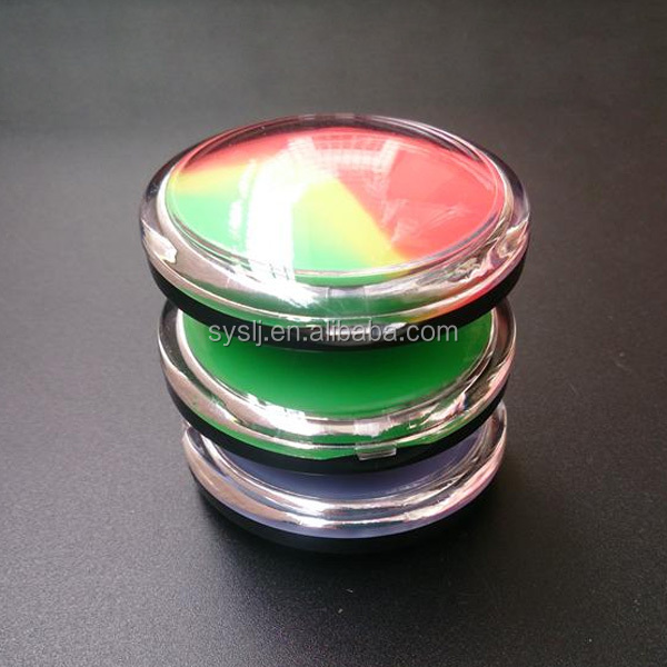 Silicone jar wax container in a acrylic box with dab tool and silicone mat.
