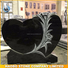 Black Galaxy Granite Heart Shaped Headstone With Carved Lilies