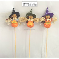Straw and fabric scarecrow with pumpkin for Halloween decoration