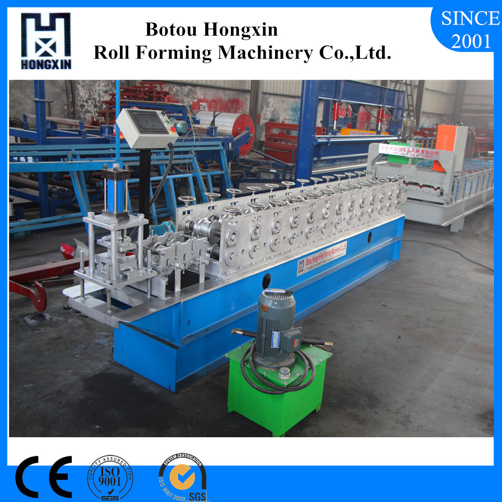 Best Quality Galvanized Plate Embossing Gear Driving Roller Shutter Door Roll Forming Machine