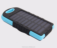 OEM factory China 8000 mah portable solar battery charger for mobile phone with led light