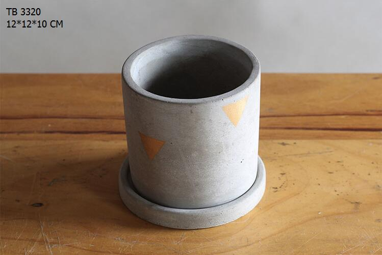 Handmade cylindrical cement planter pot with concrete water pan