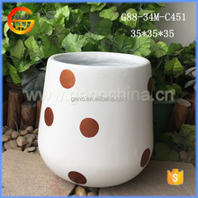 White color egg shape fiberglass flower pot with gold dot printing