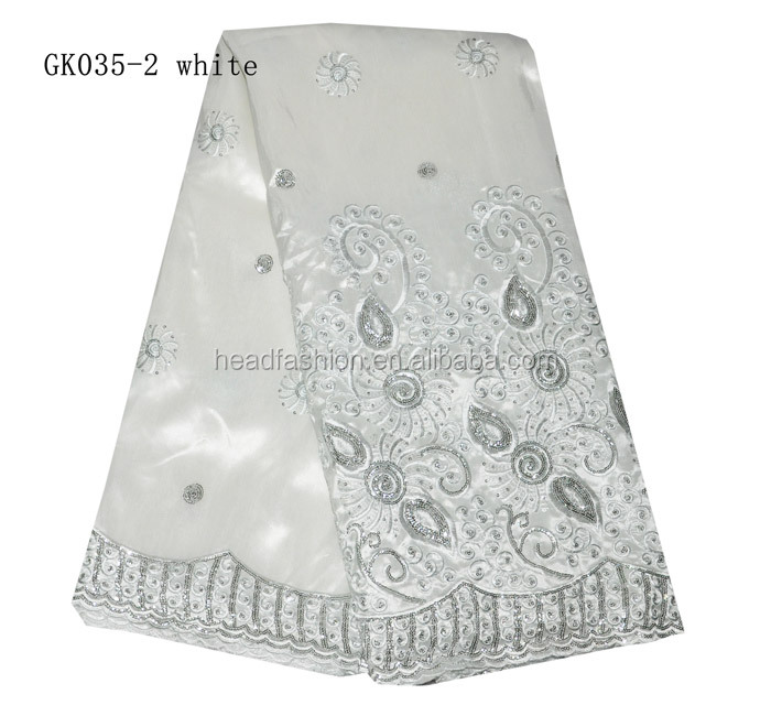 white beaded raw silk george