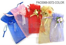 Plain colorful organza gift bags with ribbon flowers for wedding