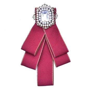 Red handmade fabric bow brooch with shining rhinestone decoration