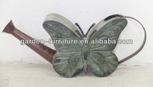 metal butterfly watering can for garden decor